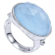 Silver Ladies Ring With .03 Ct Diamonds And Center Blue Rock Crstal